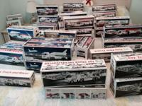 44 Hess Trucks new in box never open. (3) 1988 (5) 1989