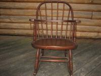 This Heywood-Wakefield wood rocking chair is over 120