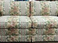 FLORAL MATERIAL COUCH WITH PULL OUT QUEEN SIZE BED.