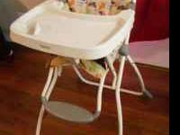 Adorable Cosco High Chair ...I would say in GREAT