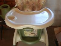 High chair that is neutral (green Pooh). Text or call