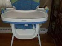 Carter's adjustable highchair. Tray removes easily with