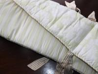 This crib bumper and crib skirt is Little House brand,