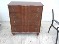 This is a Bombay Furnishings Business 4 drawer chest in