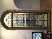 This is a very high end custom wrought iron/glass/wood
