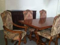 very good quality solid wood dinner table and 6 chairs,