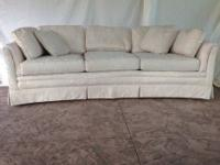 $300 or best offer. High-end Highland House Wedge Sofa.