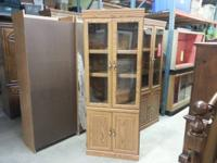 We are selling a tall cupboard with glass doors on