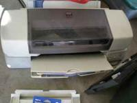 This is an EPSON STYLUS Photo 1270 printer. You might