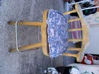 Nice blonde wood swivel bar stool with foot rung. Comes