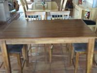 High leading cherry dining table and 6 chairs. The