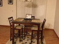 High top table (dark brown) with 4 padded (cream color)