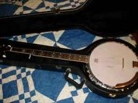 like new 5 string banjo with case. i bought this new .