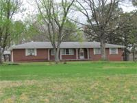 6.5 ACRES, BRICK HOME, PAVILLION, DEEP POND - situated