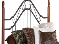 The Madison Headboard combines wood and iron to create