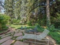Positioned on a spectacular mature landscaped lot in