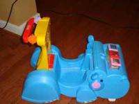Hippo push and ride toy with accessories. Great for