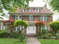 This detached brick enter hall colonial has the charm