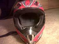 Red HJC Dirtbiking helmet. Call at  Location: Arvada
