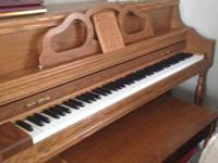 Offering an upright piano in outstanding condition,