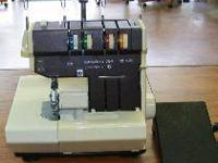Hobbylock sewing machine with cabinet and extras.  //