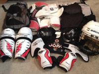 Selling roller hockey pads, pants, helmet, and bag.