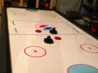 THIS IS A FULL SIZE HOCKEY TABLE.  LOADS OF FUN.