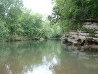 11.54 +/- acres with 452 +/- ft of river frontage on