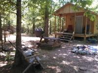 40 acres and a small cabin . mostly wooded. 5 campsites