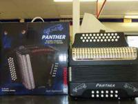 Brand new black Hohner Panther Button Accordion, comes
