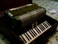 Accordion with case included. Beautiful sound and great