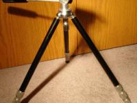 Standard tripod with two heads. $15 Call or email.