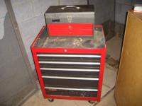 Here is great looking rolling tool chest with top tool