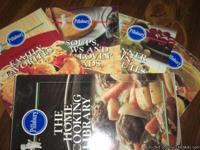 Hard cardboard case holds 4 like new cookbooks, each 92