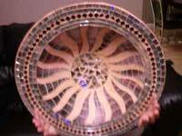 Beautiful decorative bowl with a sun design in the