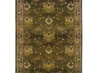 The striking Expressions Peace Area Rug in Hunter-Green