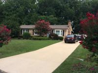 Professionally landscaped rambler home for sale on 1/2