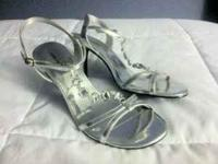 "Absolutely gorgeous silver heel (2-3"") in size 8 1/2."