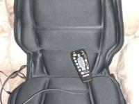 Available for sale is a black chair massager pad by