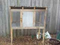 Homemade chicken coops made of reclaimed cypress. Has a