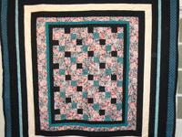 Long arm quilting service and homemade quilts. We make
