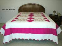This vintage homemade quilt has never been used - has