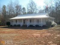 Cozy Ranch Home On Level Lot. Wrap Around Porch With