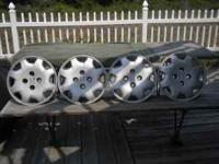 Set of four 15 inch factory Honda wheel covers .. Phone