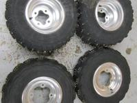 SET OF FOUR COMPLETELY STUDDED WHEELS AND TIRES  * ALL