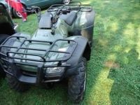 This ATV has been gently used and has low miles/hours.