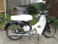 Honda Step- thru Cub 50. A blast from the past. This