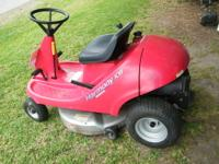 "Honda Harmony 1011 model RIding mower with a 30"" mowing"