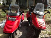 Two Honda helix scooters 1992 and 2007. The 92 has