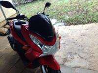 2013 Honda PCX150 windshield.  (Possibly fits many